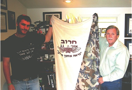 Assemblyman John Ellison receives IDF Battle pennant from Samal (Sergeant) Arieh Copelan last August.