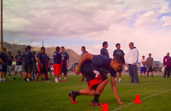 University of Nevada, Reno football coaches wear in Wendover Wednesday to conduct a mini camp for area high school players for the first time in history. Photo of WWHS senior Ryan Saiki.
