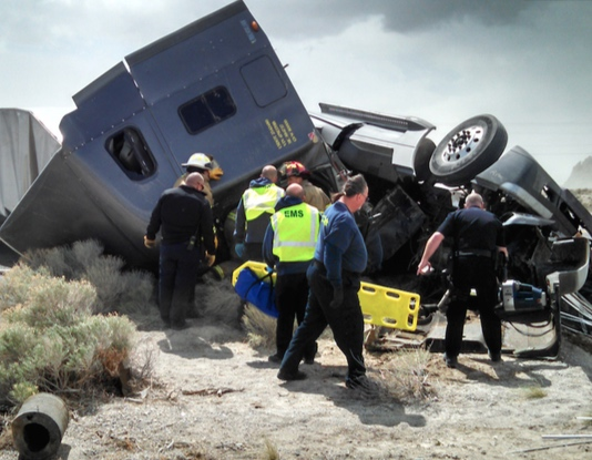 Wendover Police Firemen and EMT's rush to the aid of a truck driver.