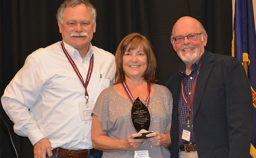 "Living With Fire Program Directors Ed Smith (left) and Sonya Sistare (middle), and Nevada Network of Fire Adapted Communities Coordinator Elwood Miller (right) received the ""Great Basin Fire Mitigation, Education and Prevention Award"" for their impact on wildfire mitigation, prevention and education. Photo courtesy of Vanesa Marquez, Nevada Bureau of Land Management."